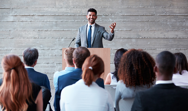 a person speaking to a group of people